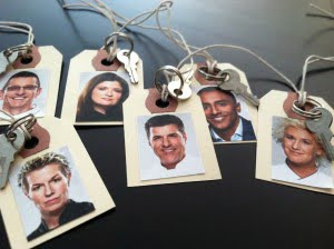 photos of the iron chefs on tags for the wine glasses
